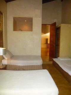 Three single beds with en-suite bathroom