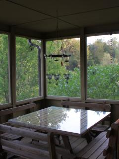 Play games by day, enjoy candlelit dinners at night on the screened porch