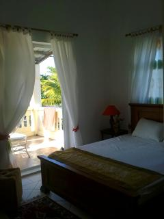 One of the bedroom with Private Balcony and Direct view of the sea