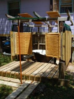 In Addition to the Interior Bathroom, A Funky Outdoor Bath House Highlights Bathing Facilities.