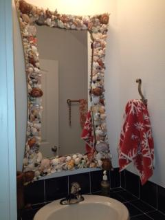Powder Bath downstairs - all hand made mirrors with shells found on the beach or bought locally.