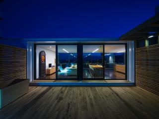 The deck at night - Huon Pine bath too