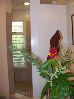 Walk through the dressing nook to find a walk-in shower for two with view of the garden.