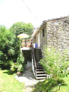 Exterior Photo of Butterfly Cottage showing the upper terrace & attractive views
