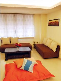 Look at the cool orange bean bag in the living room! Just for you to relax after shopping!