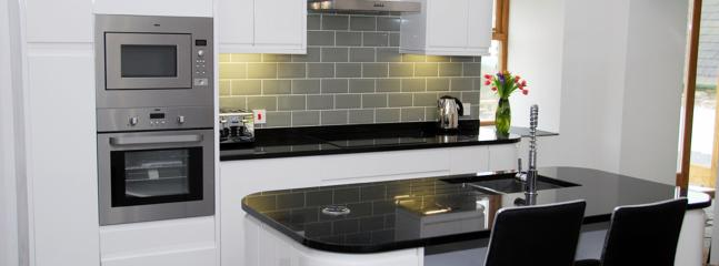 Kitchen - Induction hob, mods cons & granite surface
