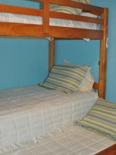 Bedroom 4 with bunk beds and pull out trundle and 1/2 bath
