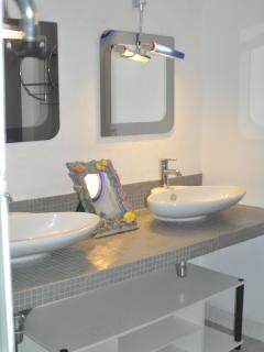 Second bathroom with dual sinks and walk in shower