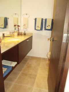 One of two equally equipped bathrooms with shower