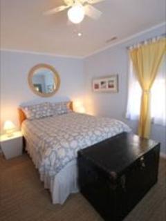 Master bedroom. Queen bed. Ceiling fan. TV.