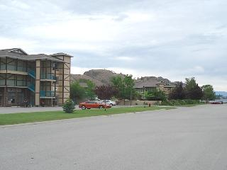 Condo building left and Skaha Lake down the road.
