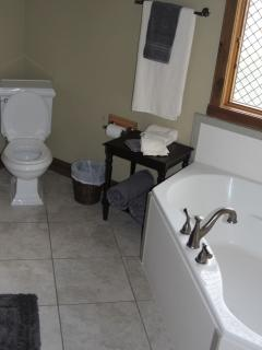 Ground floor bath with garden tub, shower, and two sinks.