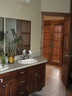 Downstairs bath with double sinks.
