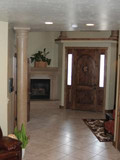 Front entry with gas fireplace to keep you cozy and seating to relax in.