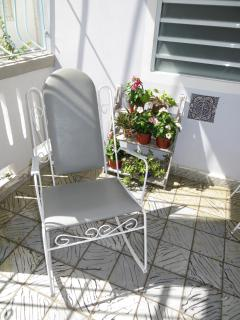 Plenty of varying sitting arrangements in the porch, livingroom, patio, balcony: rockingchair featur
