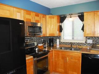 Beautifully remodeled kitchen with all new appliances, cabinets and counters.
