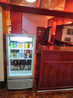 Self service drinks fridge and bar