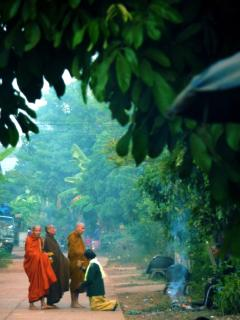 Giving alms to the monk in the village