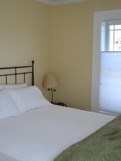 Bedroom 1: Larger bedroom with Queen bed