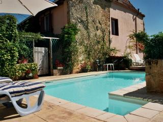 An old restored farmhouse with a pool in a quiet village near the Dordogne