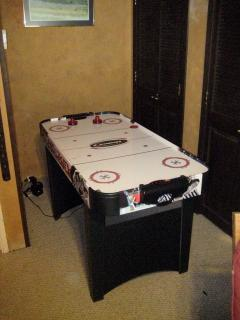 Air Hockey game in upstairs bund room.