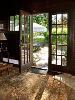 FRENCH DOORS LEAD TO STONE PATIO.