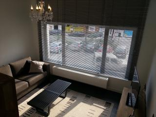 Cosy living room with a view over the little square in front, convertible sofabed.