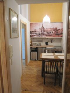 Kitchenette with dinning area, electric stove, dishwasher, frigde, sink, large table, chair