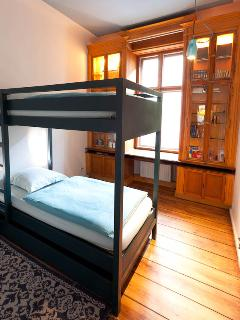 Blue Room 3 bunk beds, precious wood library and escamotable desk