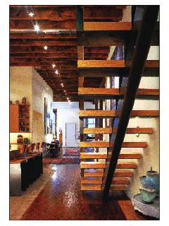 artist-built staircase to clerestory/roof deck. Also showing view toward great room