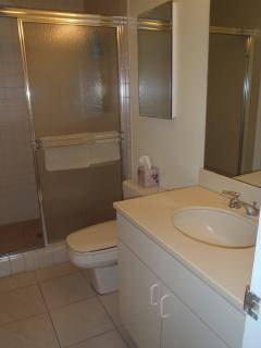 The guest bath opens to both the main living area and the guest room for privacy
