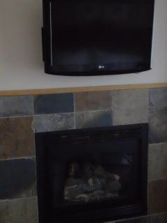 Flat Screen Television/Fireplace in Master Bedroom