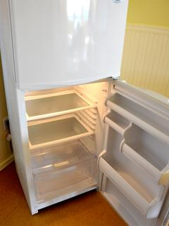 Fridge is empty and pristine upon arrival, awaiting your yummies!