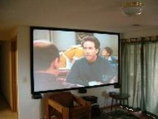 120 inch hi-def projection theater with surround sound on lower level.