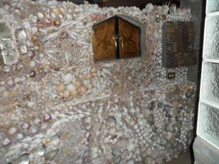 A wall of shells in the main bathroom