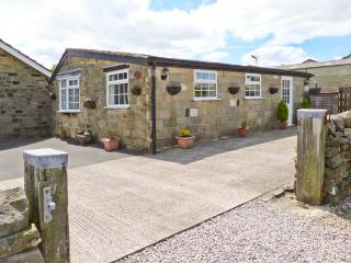 FIR TREE STABLES, single-storey pet-friendly cottage with lovely views, rural