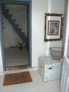 Original staircase as seen from back entryway