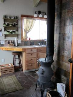 Working wood burning stove will keep you toasty warm on those chilly nights.