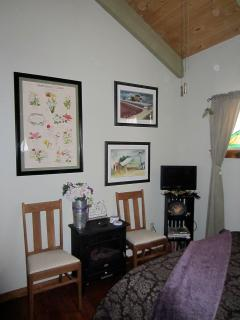 Original artwork adorn the cottage walls.