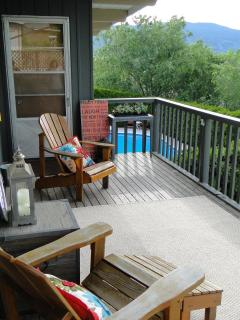 Big Deck overlooks the pool, backyard and sunset views