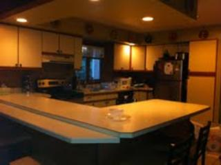 Kitchen with double sinks, spacious seating for 6, along with washer and dryer