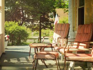Our delightful front porch offers shelter from the rain, and shade from the sun!