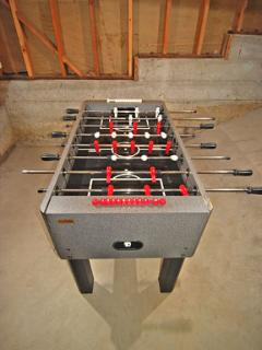 Solid Rod Foosball table in game room