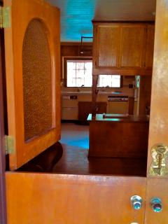 The home is full of custom woodwork, such as the old-fashioned front doors...