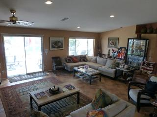 Great Room with high ceiling, recessed lighting opening to covered patio and pool