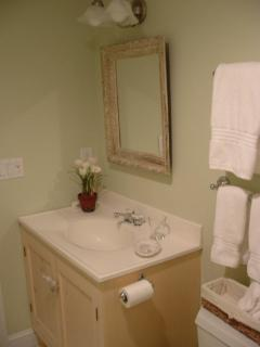 Private bathroom with glass shower stall.