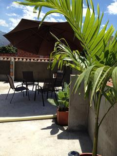 Umbrella and tables on rooftop terrace
