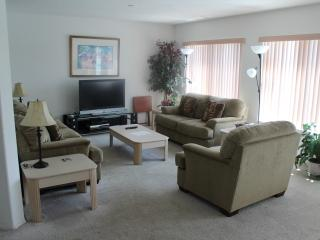 Living room with Flat Screen T.V and Cable.
