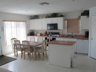 Dining and Kitchen with door to the pool.