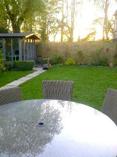 Breakfast table in the garden, with the park beyond